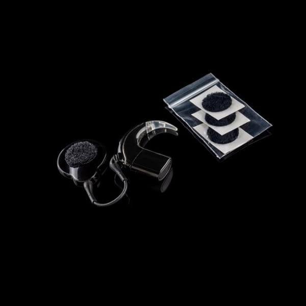 deaf metal hearing aid jewellery shown on hearing aid