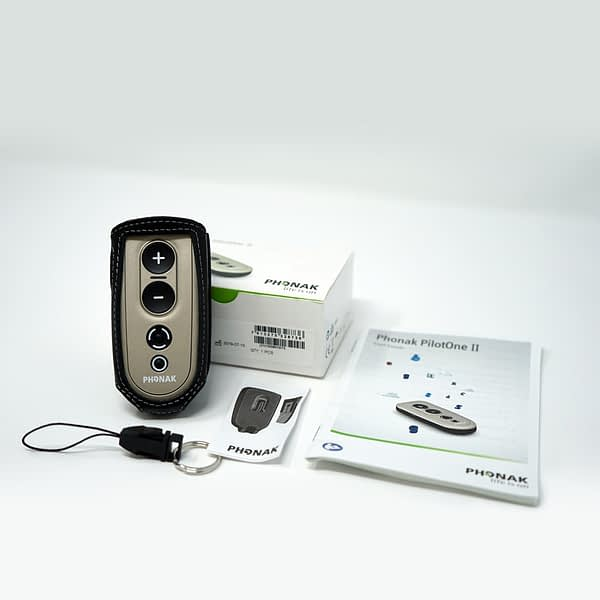 Phonak PilotOne 2 with contents of packaging laid out