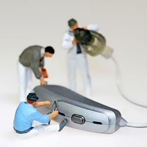 mini figures fixing hearing aid