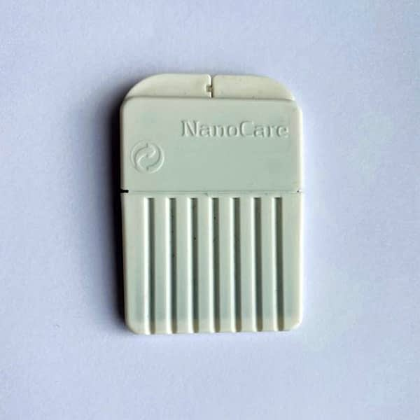 Widex Nanocare Wax Guards front view on white background