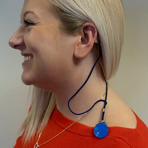 Hearing aid retention cord and clip