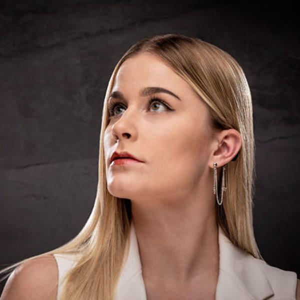 woman modelling deafmetal riley star hearing aid jewellery